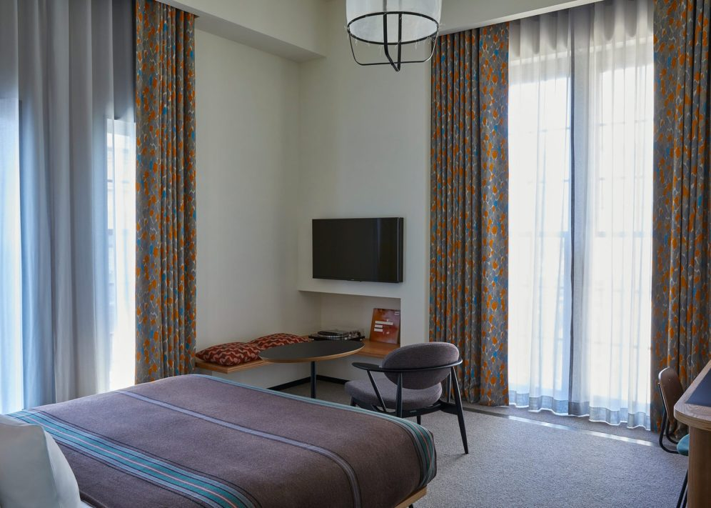 Corner hotel room with king size bed