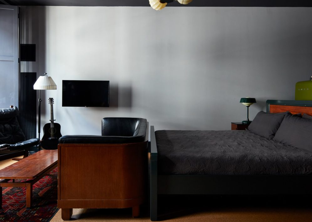 A hotel room with a large bed and seating area