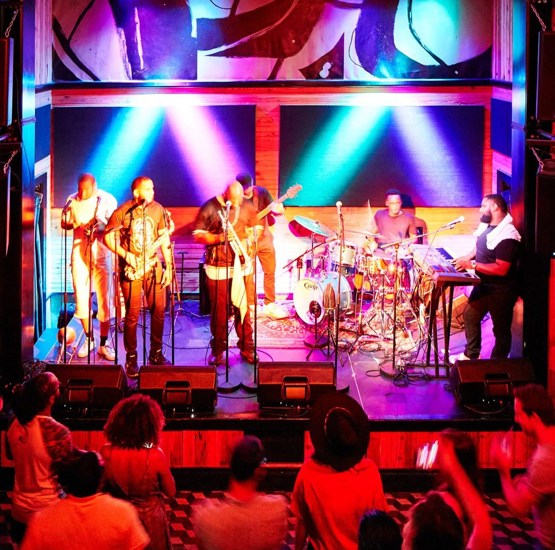 Performers on stage at the Three Keys venue