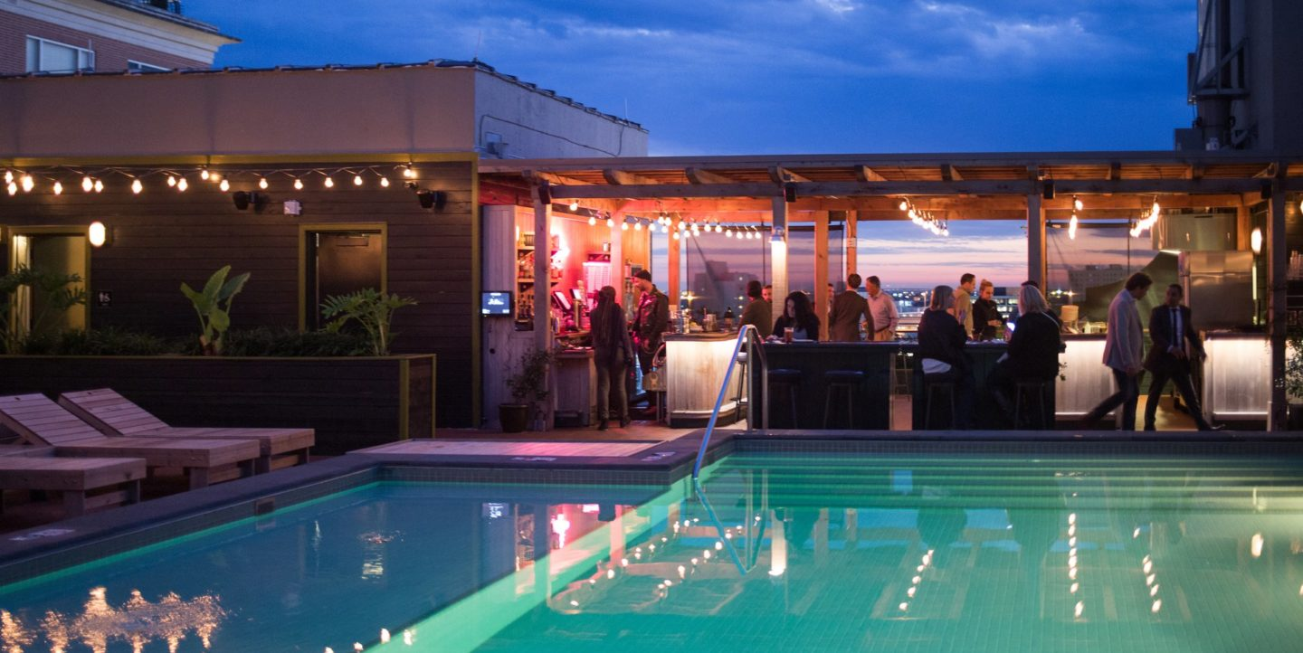 A poolside view of the outdoor Alto bar