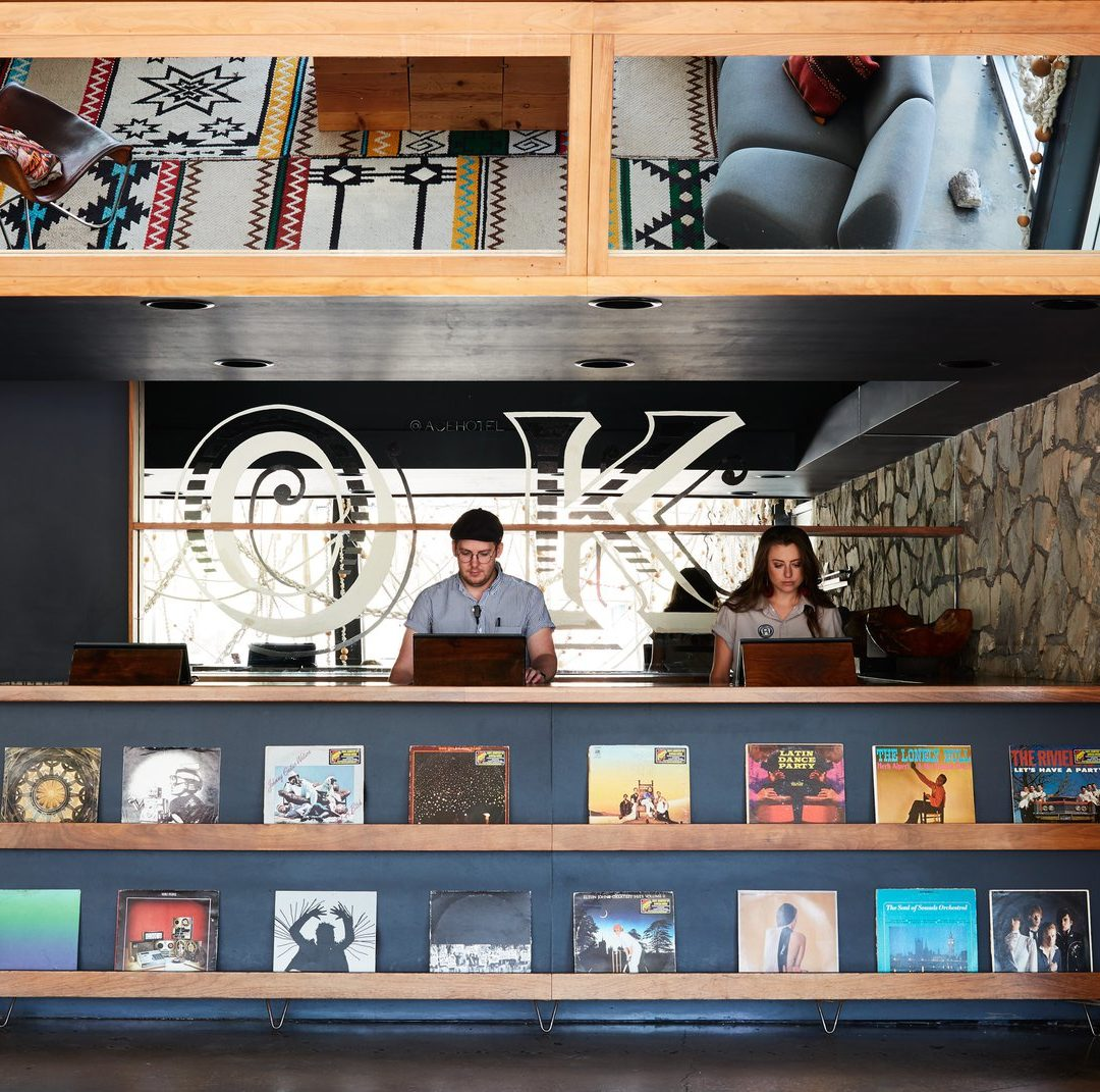 Checkout counter with records on display at the Ace Hotel shop